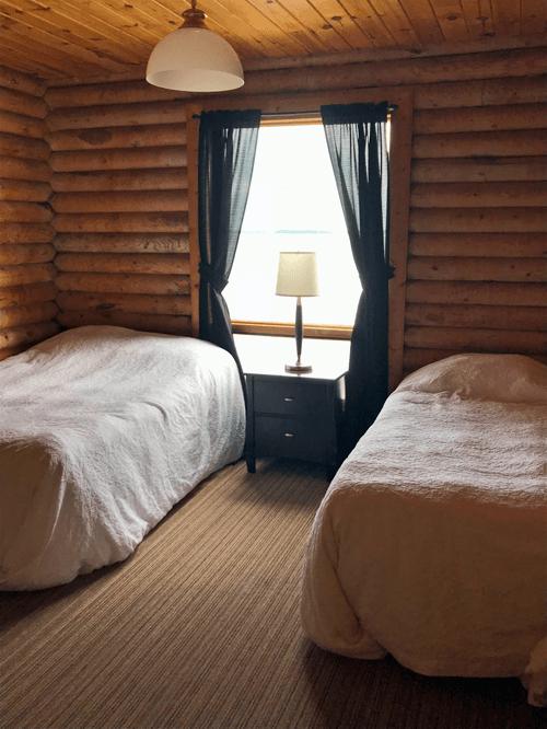 Big Log Cabin double bedroom at Budd's Gunisao Lake Lodge World's Best Trophy Walleye and Northern Pike Fishing