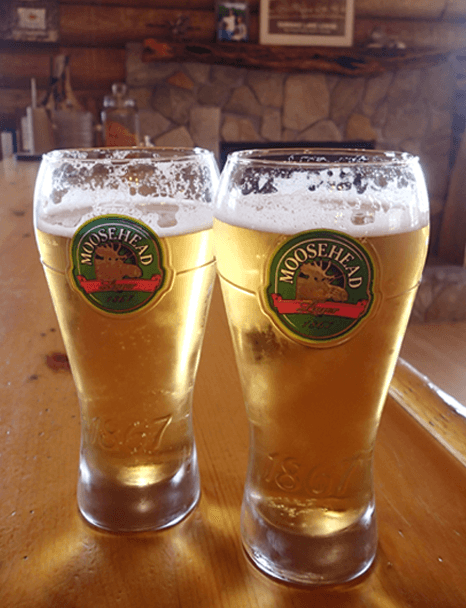Enjoy Moosehead Beer on tap at the Watering Hole Bar inside Budd's Gunisao Lake Lodge home of The World's Best Trophy Walleye and Northern Pike Fishing located in Manitoba, Canada