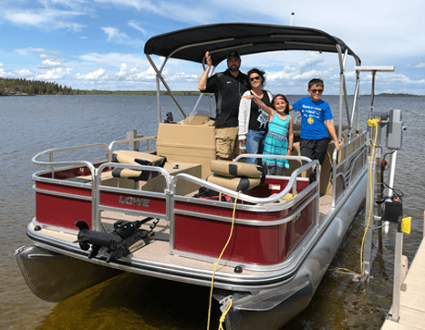 fishing from a pontoon boat at Budd's Gunisao Lake Lodge World's Best Trophy Walleye and Northern Pike Fishing, Manitoba, Canada